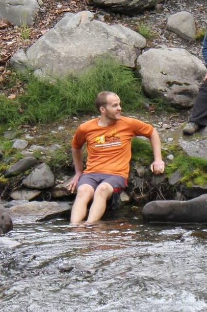 Soaking my feet in the icy cold river after the race.